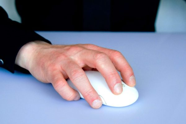 Man controlling computer mouse
